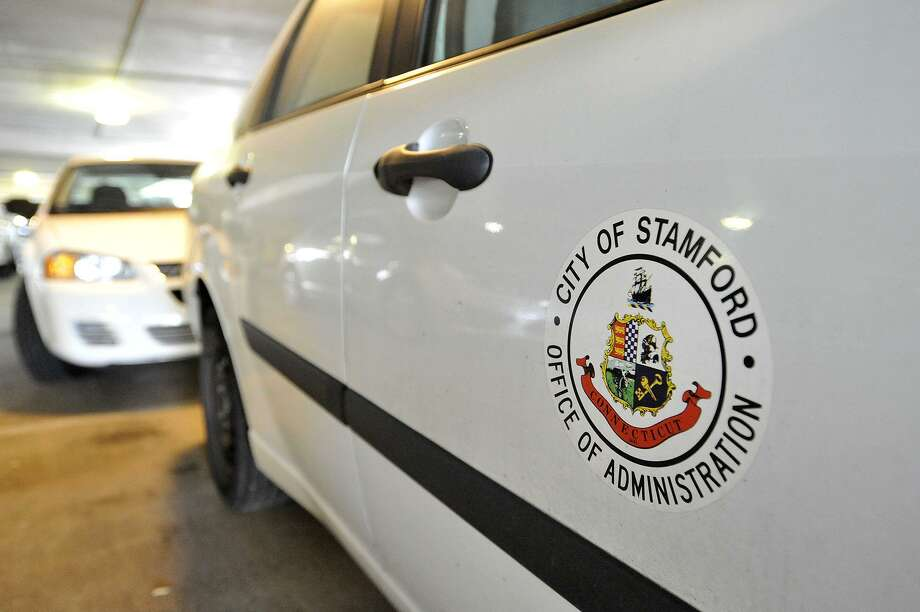 FILE - A city vehicle can be seen parked at the Stamford Government Center in Stamford, Conn., on Wednesday, Aug. 12, ,2015. Photo: Jason Rearick / Hearst Connecticut Media / Stamford Advocate