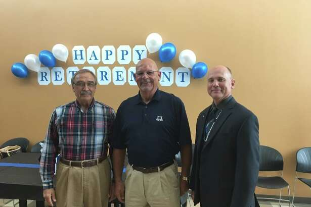 Former Pearland Police Department Chief Mike Hogg, left, and newly appointed Chief Johnny Spires, right, celebrate former Chief Chris Doyle's retirement May 31. Spires assumed command of the department June 1. Hogg served as chief from December 1990 through January 1999, and Doyle began his service in January 1999.
