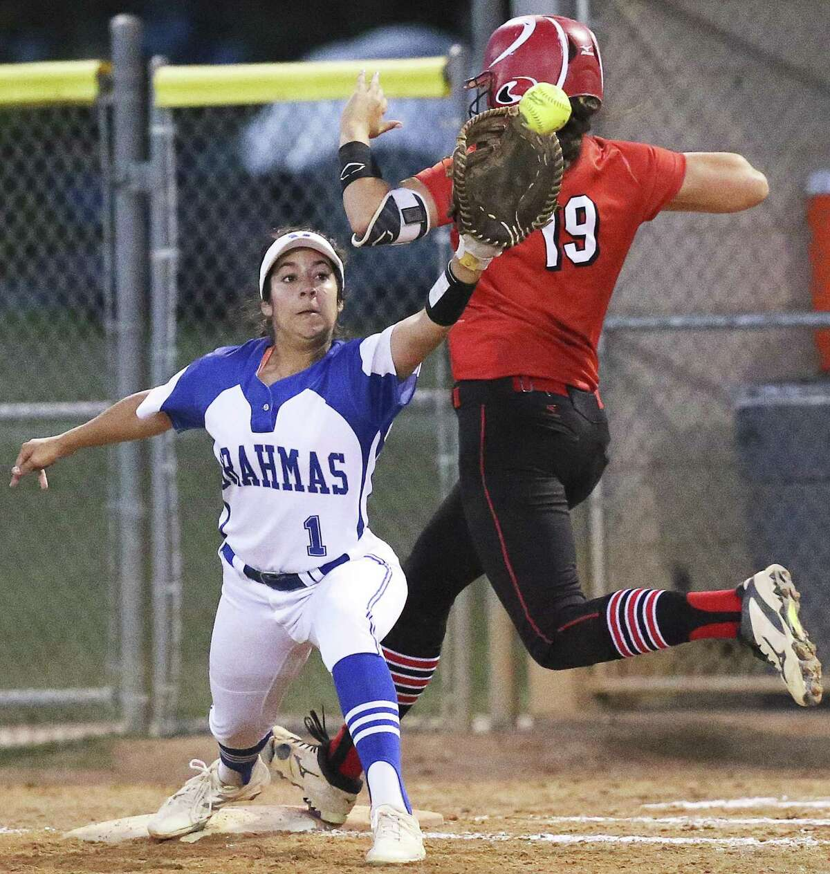 Brooke Vestal beats the throw to first as the Brahmas Kiersten Licea can't reach out far enough to make the out as Canyon plays MacArthur in clas 6A second round softball playoffs on May 5, 2017.