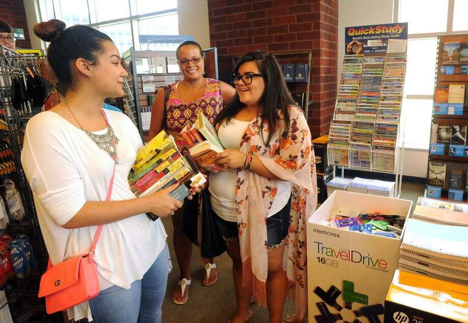 Raeda Guzman, Debra Perez and Chaz Sanchez wait in line to purchase books at Housatonic Community College in Bridgeport, Conn. on Thursday, Aug. 27, 2015. All three students are from Bridgeport. Guzman is a liberal arts/social science major, Perez is a nursing student and Sanchez is an education major with plans to transfer to Southern Conn. State University next year. Classes at HCC start on Monday. Photo: Cathy Zuraw / Hearst Connecticut Media / Connecticut Post