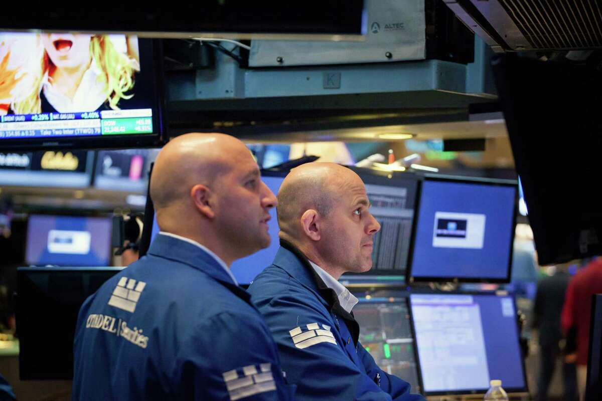 Traders work on the floor of the New York Stock Exchange on Friday. U.S. stocks reached intraday records and the dollar rose, but the British pound tumbled as the U.K.'s ruling Conservative Party lost its parliamentary majority, plunging the country into uncertainty just days before Brexit negotiations were due to start.