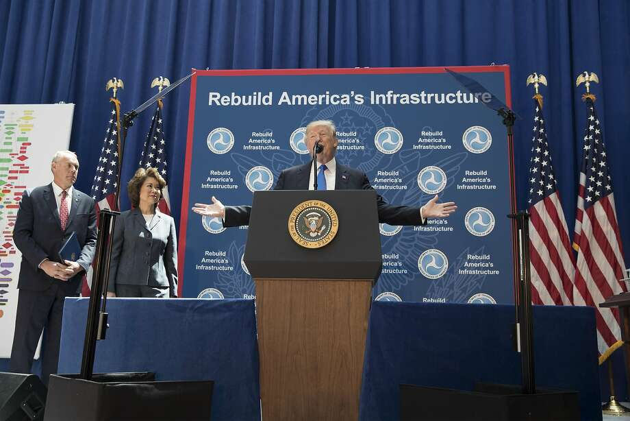 President Trump describes his infrastructure initiative at the Department of Transportation in Washington. He says his administration will drastically speed up project approvals. Photo: Michael Reynolds, Bloomberg