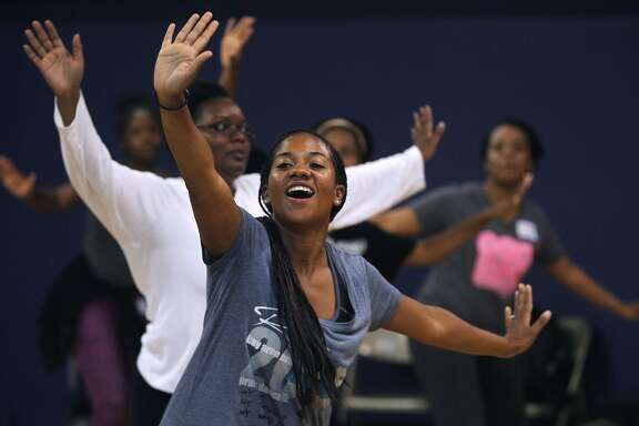 Tiana Jones-Bey dances in a class during the Praise dance convention and workshop, hosted by the faith-based Ross Dance Company in Oakland, Calif. on Saturday, June 27, 2015.
