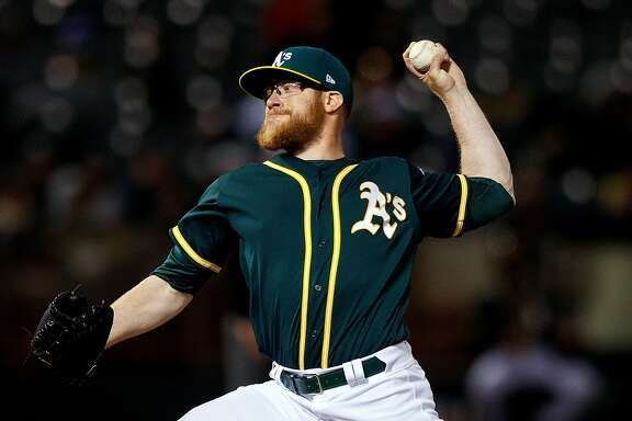 OAKLAND, CA - APRIL 18:  Sean Doolittle #62 of the Oakland Athletics pitches against the Texas Rangers during the seventh inning at the Oakland Coliseum on April 18, 2017 in Oakland, California. The Oakland Athletics defeated the Texas Rangers 4-2. (Photo by Jason O. Watson/Getty Images)