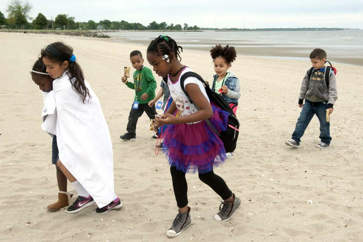 Students from the Cardinal Shehan Center's after school swim camp explore the beach during a field trip to Seaside Park in Bridgeport, Conn. June 8, 2017. The students have been learning to swim in the center's pool, and took a trip to the shore to learn about beach safety.