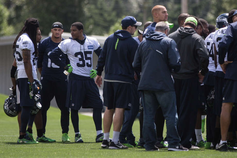 Richard Sherman, Doug Baldwin, Jermaine Kearse and DeShawn Shead talk outside the final huddle of the day following OTAs at Virginia Mason Athletic Center on Friday, June 9, 2017. Photo: GRANT HINDSLEY, SEATTLEPI.COM / SEATTLEPI.COM
