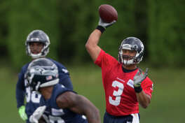 Seahawks quarterback Russell Wilson throws a pass during OTAs at Virginia Mason Athletic Center on Friday, June 9, 2017.