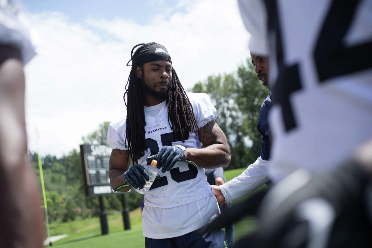 Seahawks cornerback Richard Sherman walks off the field following OTAs at Virginia Mason Athletic Center on Friday, June 9, 2017.