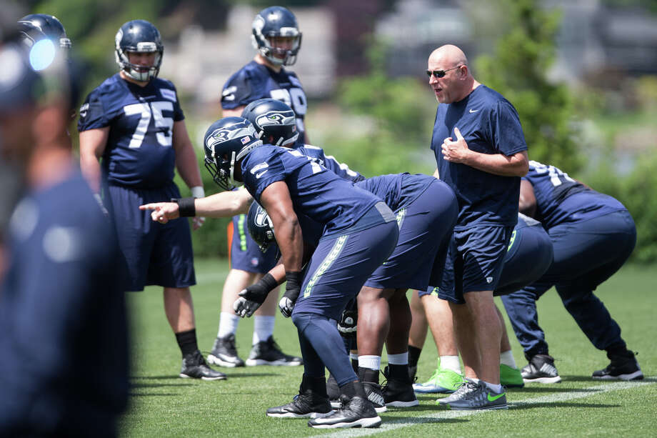 Offensive line coach Tom Cable works with players during OTAs at Virginia Mason Athletic Center on Friday, June 9, 2017. Photo: GRANT HINDSLEY, SEATTLEPI.COM / SEATTLEPI.COM