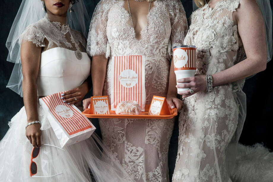 The brides show-off the latest in Whataburger swag. Tenenbaum Jewelers, Abrahams Oriental Rugs, and Mitchell Gold + Bob Williams furnishings shown throughout. Photo: Michael Ciaglo, Houston Chronicle / Michael Ciaglo