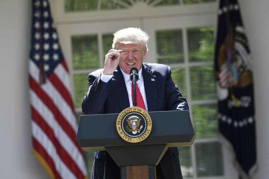 President Donald Trump announces his decision to withdraw the US from the Paris Climate Accords in the Rose Garden of the White House in Washington on June 1. He was correct to do so because the pact would cause U.S. economic damage. Photo: SAUL LOEB /AFP /Getty Images / AFP or licensors