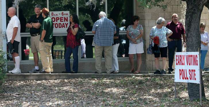 People line up to vote in May 2017 at the Brook Hollow Branch Public Library. The U.S. Department of Justice says the Texas Legislature has corrected problems with its voter identification law and it's no longer discriminatory.
