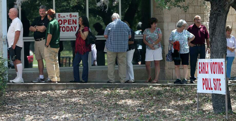 People line up to vote in May 2017 at the Brook Hollow Branch Public Library. The U.S. Department of Justice says the Texas Legislature has corrected problems with its voter identification law and it's no longer discriminatory. Photo: John Davenport /San Antonio Express-News / ©John Davenport/San Antonio Express-News