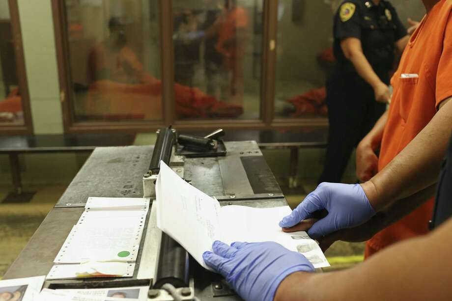It's estimated that 95 percent of all warrants issued in Texas last year were for fine-related offenses. Failure to pay can cause debts to spiral and imperil jobs. Photo: JERRY LARA /San Antonio Express-News / © 2016 San Antonio Express-News