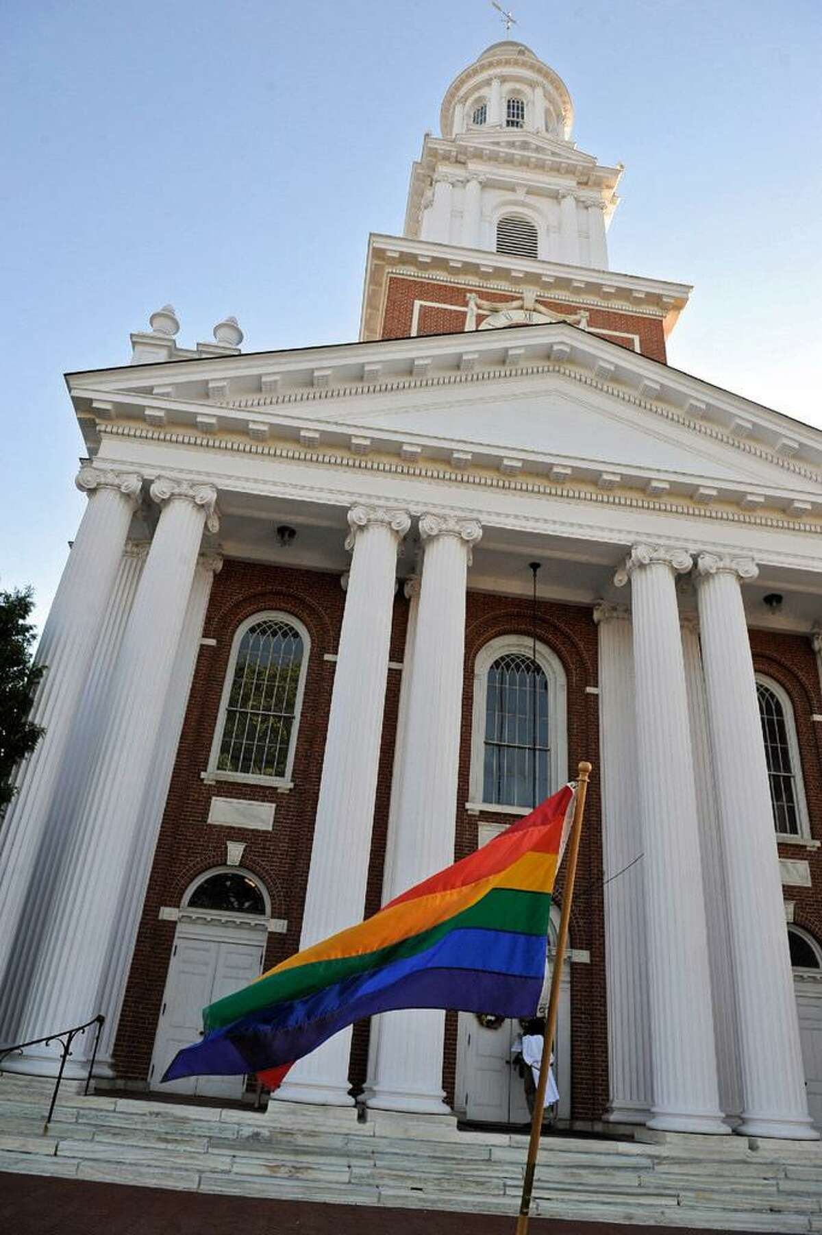A rainbow flag flies in front of the First Congregational Church of Danbury during a 2016 vigil to honor those killed in the nightclub shooting in Orlando, Fl.