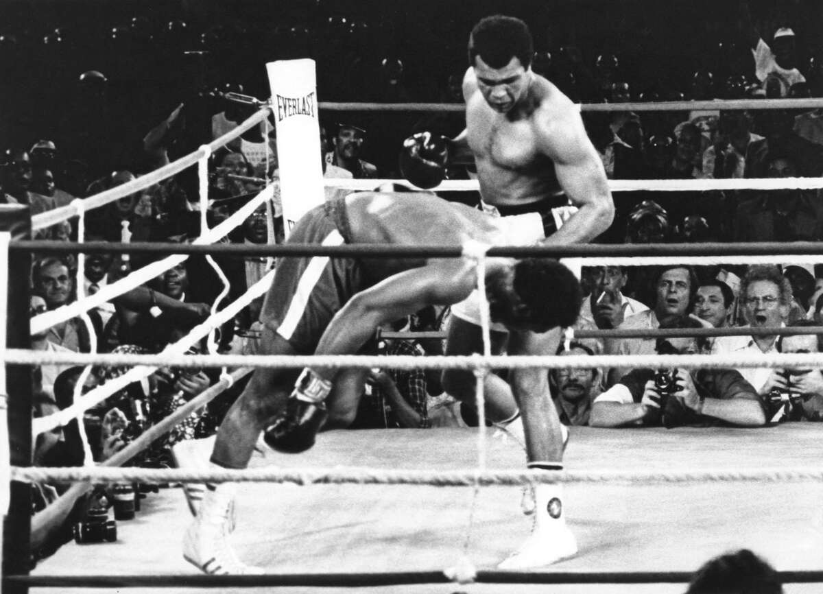 """Muhammad Ali sends George Foreman nose-diving to the the canvas in 1974, one of the greatest upsets in boxing history. A reader remembers """"The Greatest"""" about a year after his death."""