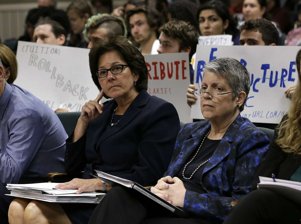 FILE - In this Tuesday, May 2, 2017 file photo, Monica Lozano, left, chair of the University of California Board of Regents, and UC President Janet Napolitano, sit in the audience before appearing before the Joint Legislative Audit Committee in Sacramento, Calif. Frustrated by the rising cost of college, Gov. Jerry Brown and lawmakers have floated a variety of plans to boost enrollment, restrain costs and hold University of California administrators accountable. Brown wants to hold back $50 million of UC funding until Napolitano's office shows it's complying with recommendations from a scathing audit of her office. (AP Photo/Rich Pedroncelli, File)