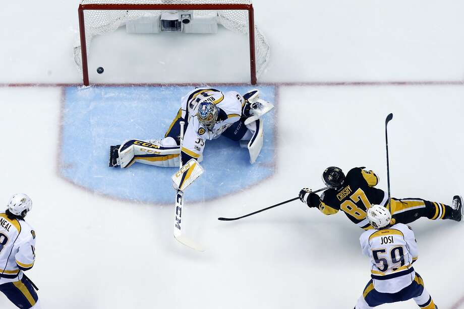 A shot by Pittsburgh Penguins' Sidney Crosby (87) goes off the left post behind Nashville Predators goalie Pekka Rinne (35) after being held by Predators' Ryan Ellis during the first period of Game 5 of the NHL Stanley Cup Final, Thursday, June 8, 2017, in Pittsburgh. The penalty set up the Penguins first power play and goal. The Penguins won 6-0. (AP Photo/Gene J. Puskar) Photo: Gene J. Puskar, Associated Press
