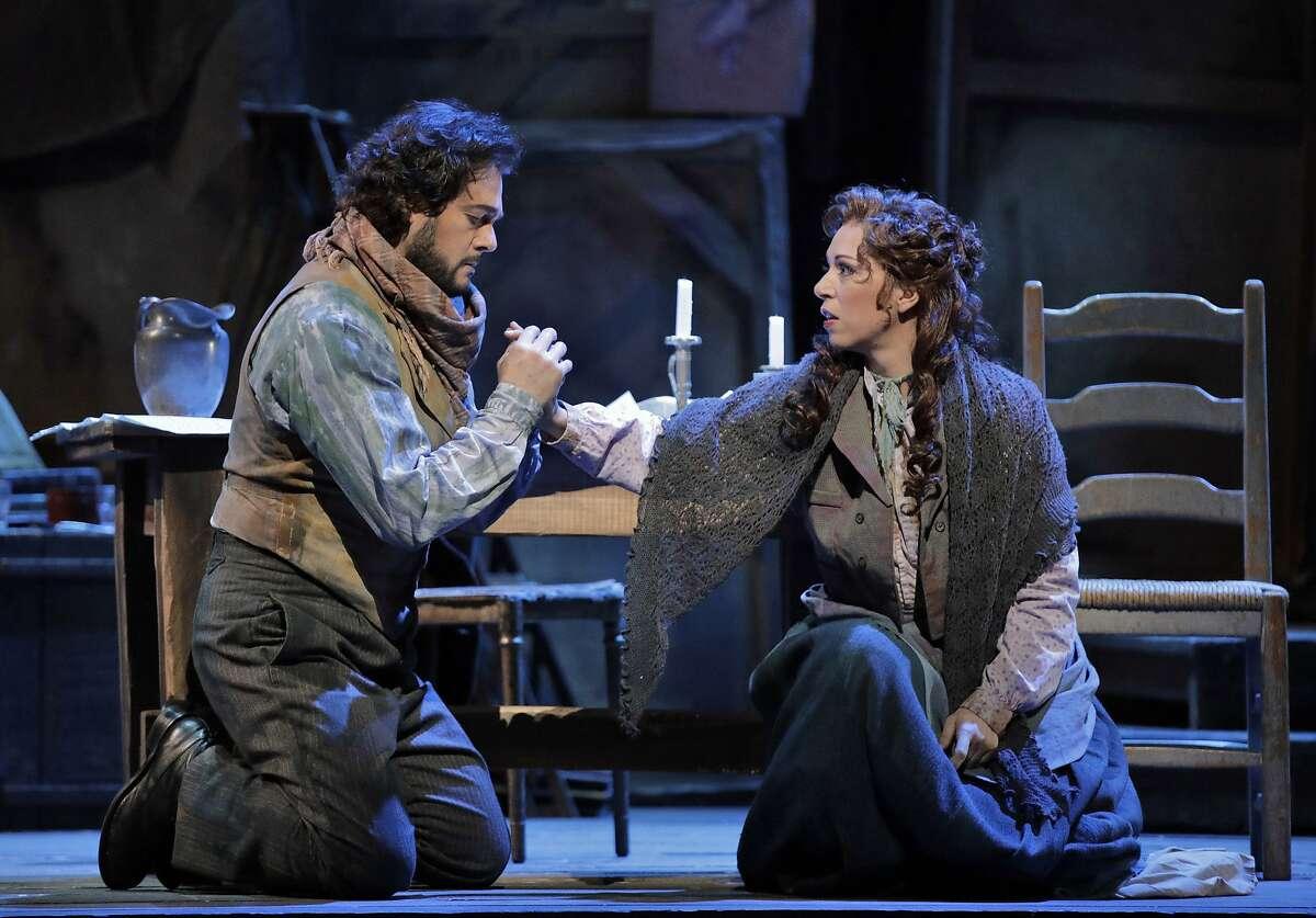 "Arturo Chacón-Cruz (l.) as Rodolfo and Erika Grimaldi as Mimì in Puccini's ""La Bohème."""