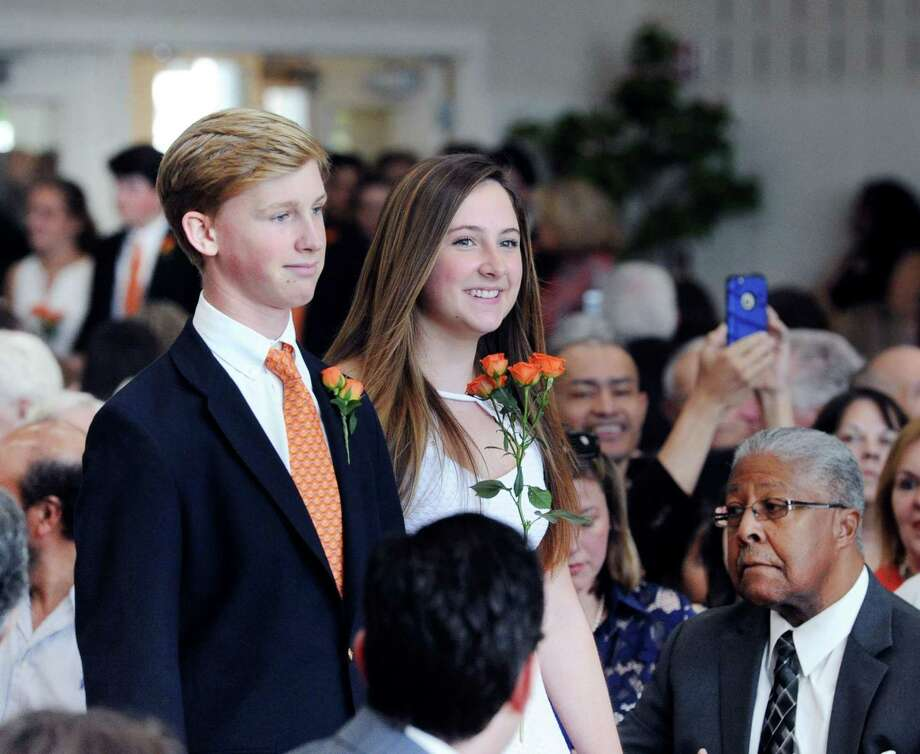 Greenwich Country Day School ninth grade students Joseph Delany, left, and Eva Moore during their commencement at the school in Greenwich, Conn., Friday, June 9, 2017. Photo: Bob Luckey Jr. / Hearst Connecticut Media / Greenwich Time