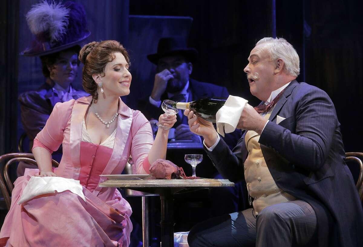 "Ellie Dehn (l.) as Musetta and Dale Travis as Alcindoro in Puccini's ""La Boh�me."""