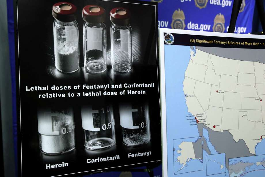 A Seattle-area man is accused of importing ounces of the prescription painkiller fentanyl from China. Above, a poster comparing lethal amounts of heroin, fentanyl and carfentanil is on displayed during a news conference about the dangers of fentanyl, at DEA Headquarters in June. Photo: Jacquelyn Martin / Associated Press / Copyright 2017 The Associated Press. All rights reserved.