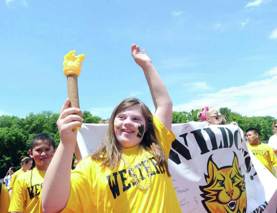 Western Middle School eighth grade student Nancy Stambaugh, 14, had the honor of carrying the torch as she lead the Unified school teams during the pre-competition march during the first annual Unified Sports/Special Olympics Field Day on the track at Greenwich High School, Conn., Friday, June 9, 2017. All the middle schools in the district participated along with a team from Greenwich High School as well as teams from Port Chester High School and Middle School of N.Y. Photo: Bob Luckey Jr. / Hearst Connecticut Media / Greenwich Time