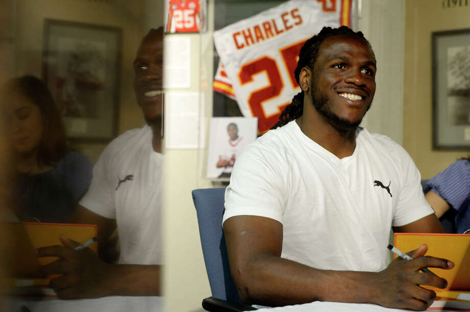 "Jamaal Charles, a Port Arthur native who plays for the Denver Broncos, signs copies of his book ""The Middle School Rules of Jamaal Charles"" at the Museum of the Gulf Coast on Friday.  Photo taken Friday 6/9/17 Ryan Pelham/The Enterprise Photo: Ryan Pelham / ©2017 The Beaumont Enterprise/Ryan Pelham"