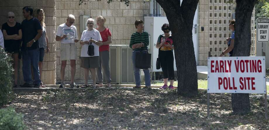 People line up to vote Tuesday May 30, 2017, at the Brook Hollow Branch Public Library. Voters have a chance to cast ballots for mayoral and City Council runoff races until 7 p.m. today. Photo: John Davenport, STAFF / San Antonio Express-News / ©John Davenport/San Antonio Express-News
