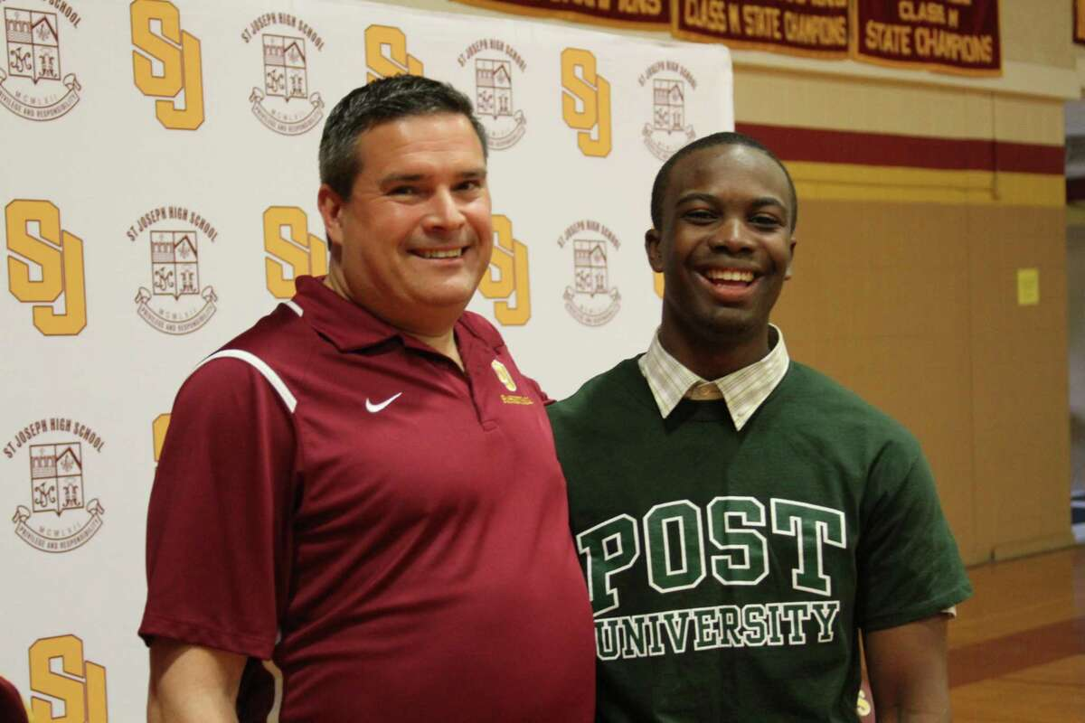 St. Joseph point guard Omar Telfer, right, seen with coach Paul Dudzinski, has chosen to attend and play basketball at Post University in Waterbury.