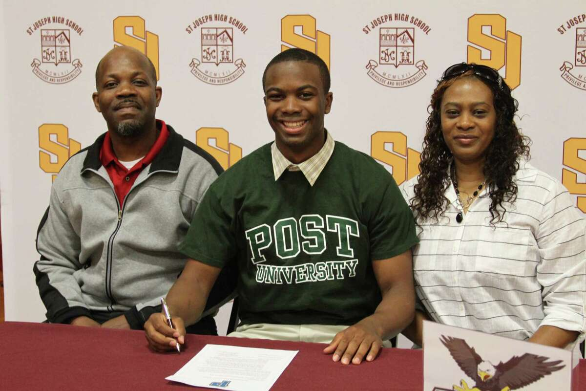 St. Joseph point guard Omar Telfer, center, seen with his parents Omar and Rose Telfer, has chosen to attend and play basketball at Post University in Waterbury.