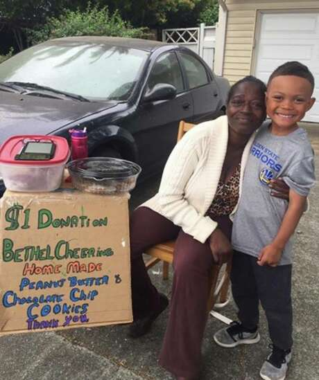 The Cookie Lady poses with the son of Judith Vinluan Wright. Photo: Judith Vinluan Wright, Frank Somerville