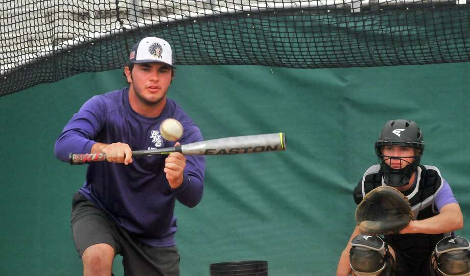 Port Neches-Groves senior Zach Murdock bunts as the team held ité¢Â€Â™s final practice Friday at Hutto High School. PN-G faces Grapevine on Saturday in the Class 5A state baseball final. (Mike Tobias/The Enterprise) Photo: Mike Tobias/The Enterprise