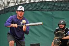 Port Neches-Groves senior Zach Murdock bunts as the team held ité¢Â€Â™s final practice Friday at Hutto High School. PN-G faces Grapevine on Saturday in the Class 5A state baseball final. (Mike Tobias/The Enterprise)