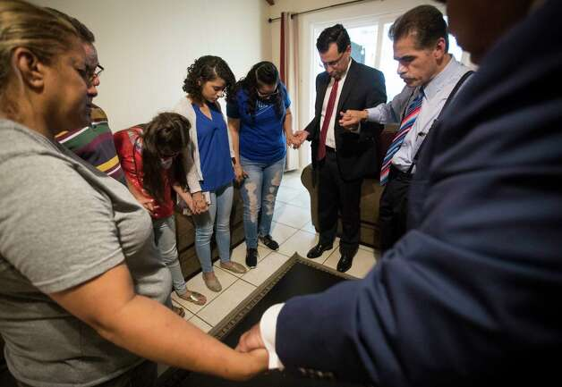 Juan F. Vasquez, Jr., David Calvillo, and former Texas Supreme Court Justice David Medina, right, pray with the Rodriguez family at their home, Thursday, June 8, 2017, in Houston. The attorneys were moved by the immigration struggle the family has been facing for the past sixteen years. Juan Rodriguez the father, has been told to turn himself in to be deported to El Salvador. Photo: Marie D. De Jesus, Houston Chronicle / © 2017 Houston Chronicle