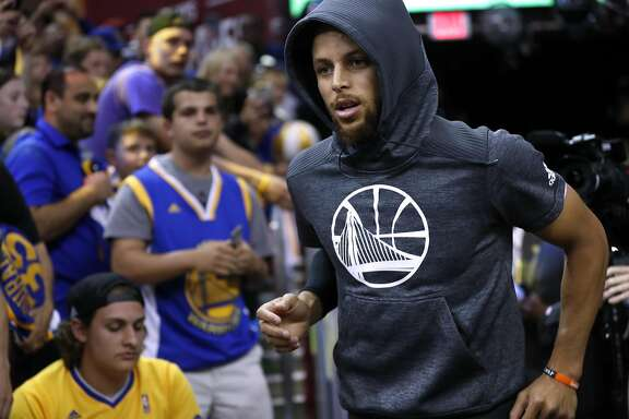Golden State Warriors' Stephen Curry heads out to warm up before playing Cleveland Cavaliers in Game 4 of NBA Finals at Quicken Loans Arena in Cleveland, Ohio, on Friday, June 9, 2017.
