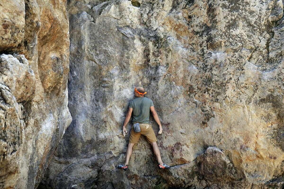 Ryan Crochiert climbs Indian Rock Traverse at Indian Rock Park on June 9, 2017 in Berkeley, CA.