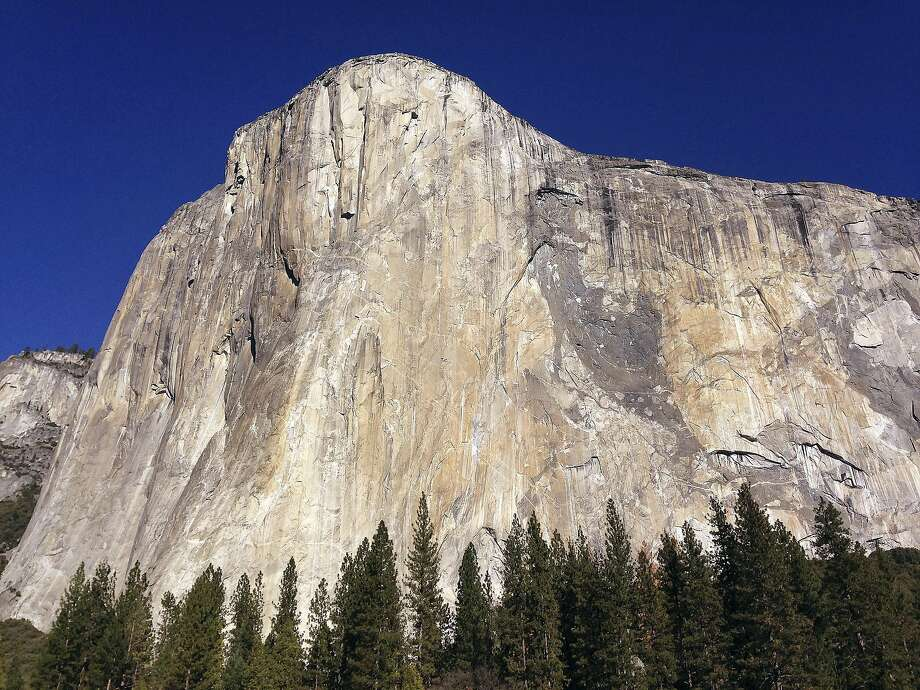 """FILE - This Jan. 14, 2015 file photo shows El Capitan in Yosemite National Park, Calif. An elite rock climber has become the first to climb alone to the top of the massive granite wall in Yosemite National Park without ropes or safety gear. National Geographic documented Alex Honnold's historic ascent of El Capitan on Saturday, June 3, 2017, saying the 31-year-old completed the """"free solo"""" climb Saturday in nearly four hours. (AP Photo/Ben Margot, File) Photo: Ben Margot, Associated Press"""