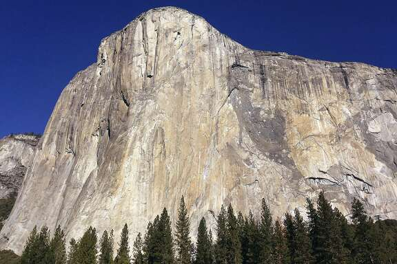 """FILE - This Jan. 14, 2015 file photo shows El Capitan in Yosemite National Park, Calif. An elite rock climber has become the first to climb alone to the top of the massive granite wall in Yosemite National Park without ropes or safety gear. National Geographic documented Alex Honnold's historic ascent of El Capitan on Saturday, June 3, 2017, saying the 31-year-old completed the """"free solo"""" climb Saturday in nearly four hours. (AP Photo/Ben Margot, File)"""