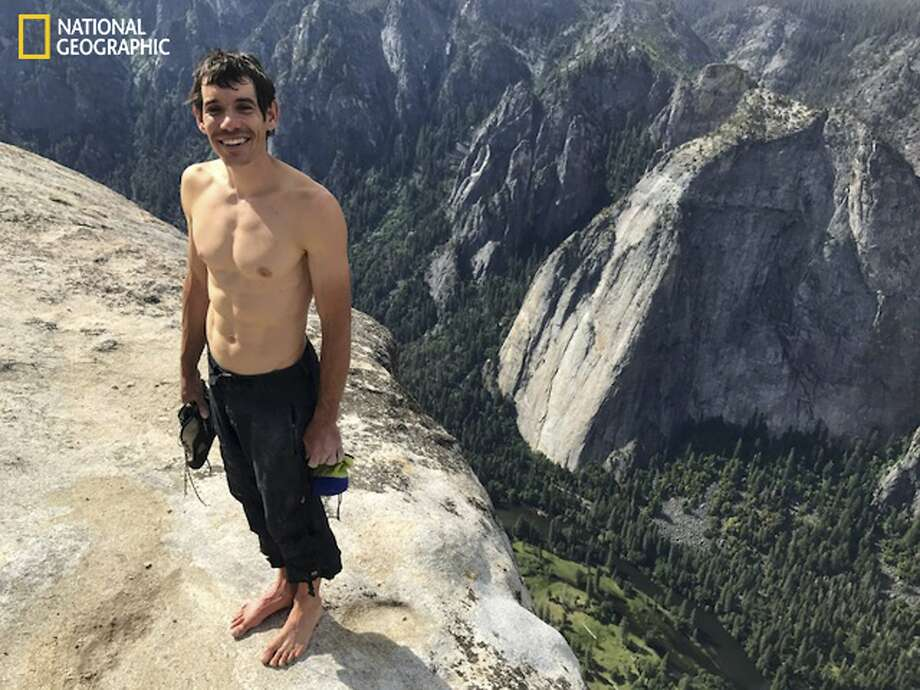 "This Saturday, June 3, 2017, photo provided by National Geographic shows Alex Honnold atop El Capitan in Yosemite National Park, Calif., after he became the first person to climb alone to the top of the massive granite wall without ropes or safety gear. National Geographic recorded Honnold's historic ascent, saying the 31-year-old completed the ""free solo"" climb Saturday in nearly four hours. The event was documented for an upcoming National Geographic feature film and magazine story. (Jimmy Chin/National Geographic via AP) Photo: Jimmy Chin, Associated Press"