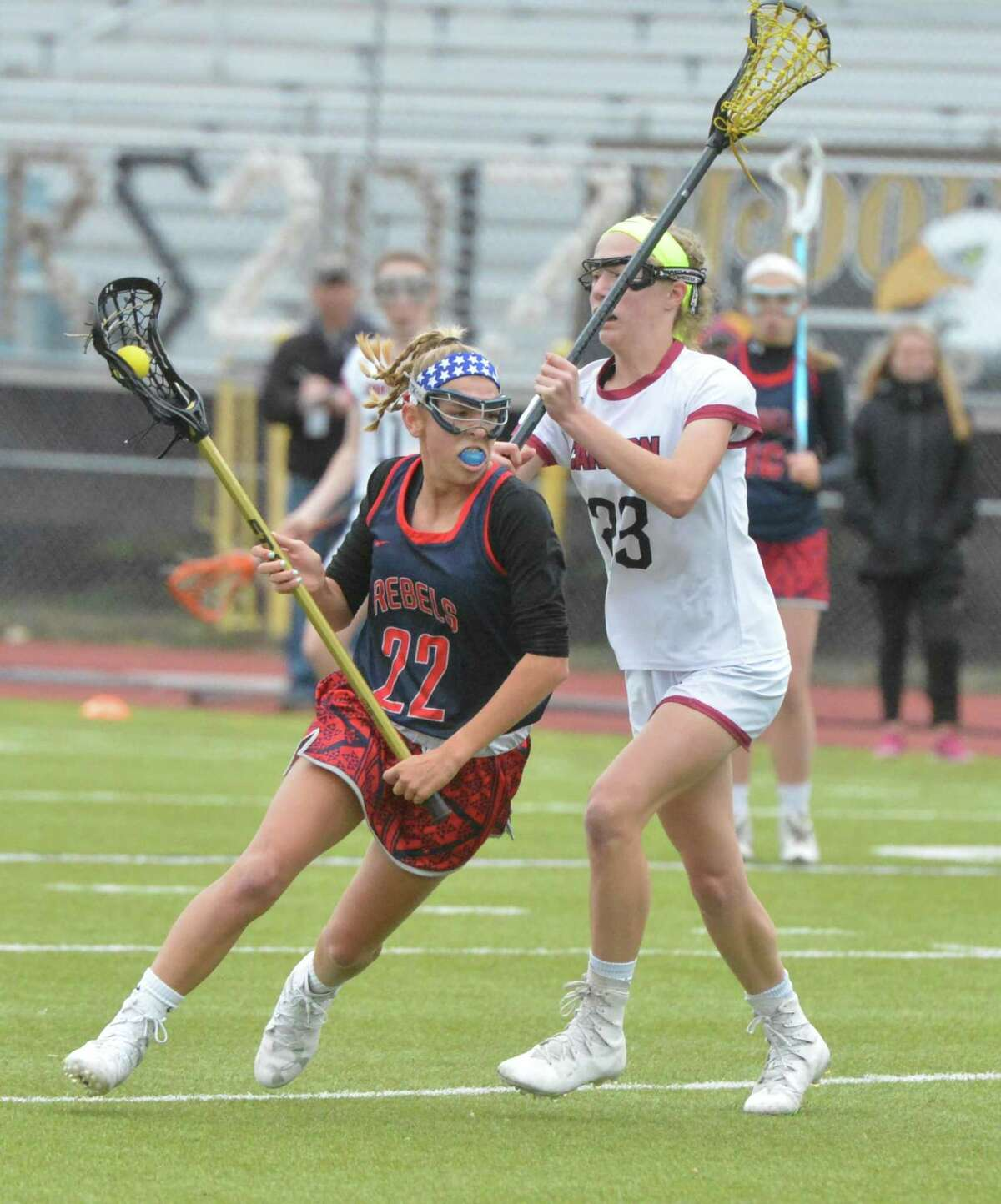 New Fairfield's #22 Daria Bock moves the ball vs. Canton during Class S semifinal playoff action on Tuesday June 6, 2017 in Trumbull Conn.