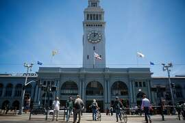 People enter  the renovated marketplace in the Ferry Building in San Francisco on June 9, 2017.