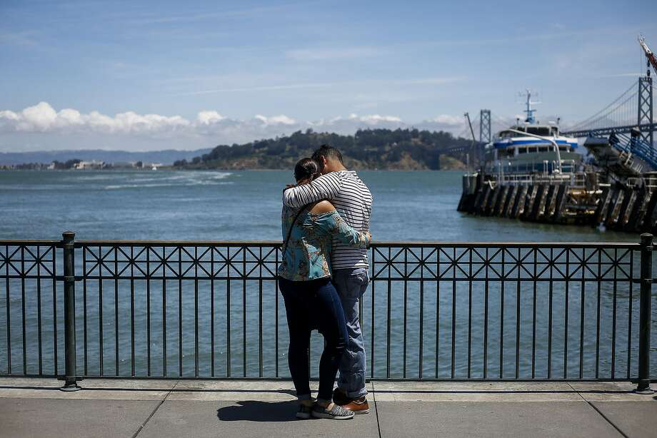 Daniel Diaz, right, and Beatriz Valvez, left, embrace outside the Ferry Building in San Francisco on June 9, 2017. Photo: Nicole Boliaux, The Chronicle