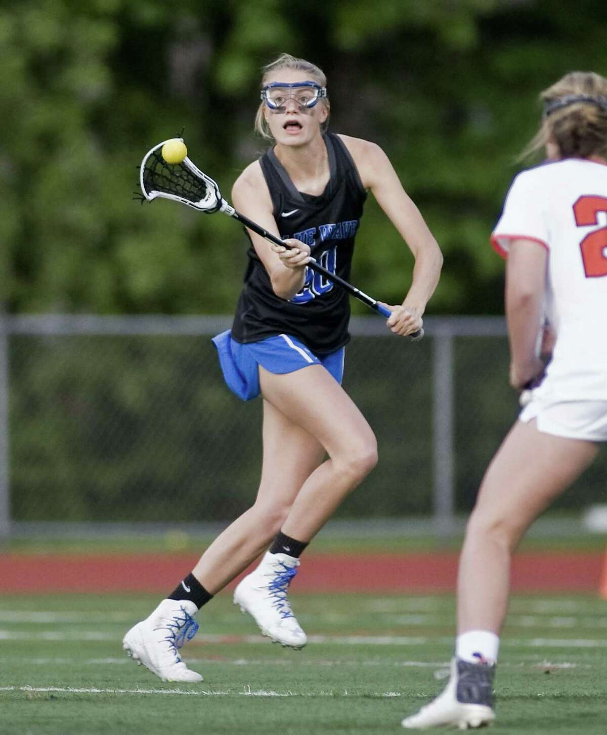 Darien High School's Katie Ramsay receives the ball in the FCIAC girls lacrosse finals against Ridgefield High School, played at Norwalk High School. Wednesday, May 24, 2017