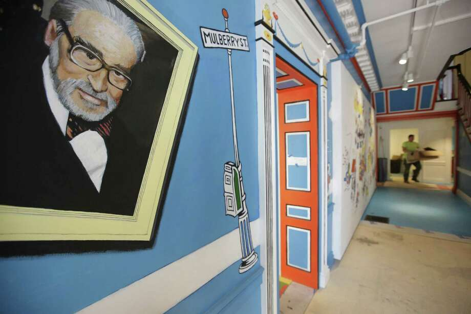 A mural that features Theodor Seuss Geisel (left), also know by his pen name Dr. Seuss, rests on a wall near an entrance at The Amazing World of Dr. Seuss Museum in Springfield, Mass. Photo: Steven Senne /Associated Press / Copyright 2017 The Associated Press. All rights reserved.