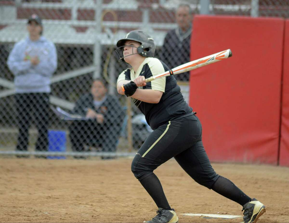 Trumbull's Delilha Destefano follows through on her two-run homer in the seventh against Stamford in a CIAC Class LL girls softball semifinal game at DeLuca Field in Stratford on Thursday. Trumbull faces Southington in the final on Saturday night.