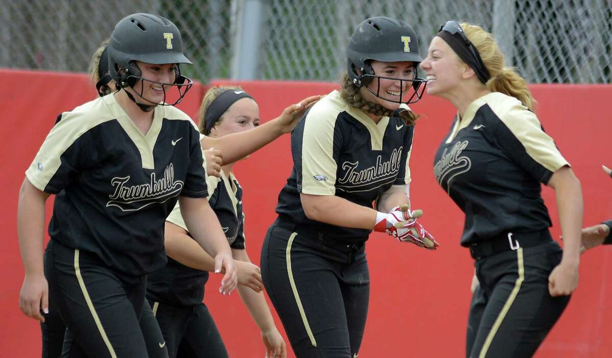 Trumbull's Lea Thompson, second from right, celebrates her seventh-inning home run against Stamford in a CIAC Class LL girls softball semifinal game at DeLuca Field in Stratford on Thursday. Trumbull faces Southington in the final on Saturday night.