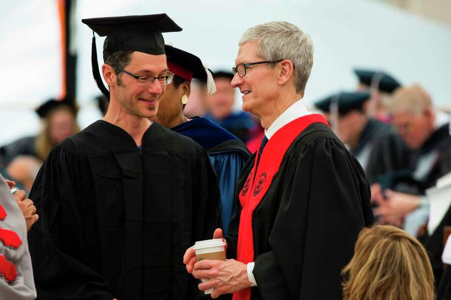 """In this image released by Massachusetts Institute of Technology (MIT), Apple CEO Tim Cook (R) participates in commencement ceremonies at MIT on June 9, 2017, in Cambridge, Massachusetts. / AFP PHOTO / Dominick Reuter / RESTRICTED TO EDITORIAL USE - MANDATORY CREDIT """"AFP PHOTO / Massachusetts Institute of Technology / Dominick REUTER"""" - NO MARKETING NO ADVERTISING CAMPAIGNS - DISTRIBUTED AS A SERVICE TO CLIENTS == NO ARCHIVE DOMINICK REUTER/AFP/Getty Images Photo: DOMINICK REUTER / AFP or licensors"""