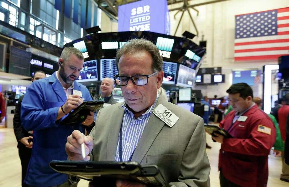 Stock trader Salvatore Suarino works at the New York Stock Exchange, Friday, June 9, 2017. (AP Photo/Richard Drew) Photo: Richard Drew, STF / AP