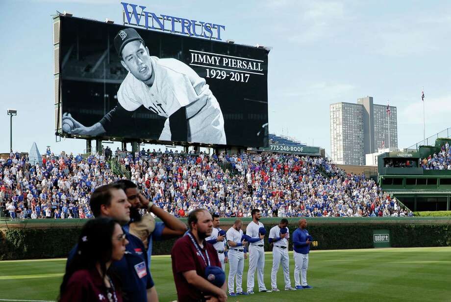 A moment of silence was held before the game between the Chicago Cubs and the St. Louis Cardinals in memory of former baseball player Jimmy Piersall at Wrigley Field on June 4, 2017 in Chicago.  (Photo by Jon Durr/Getty Images) Photo: Jon Durr, Stringer / 2017 Getty Images